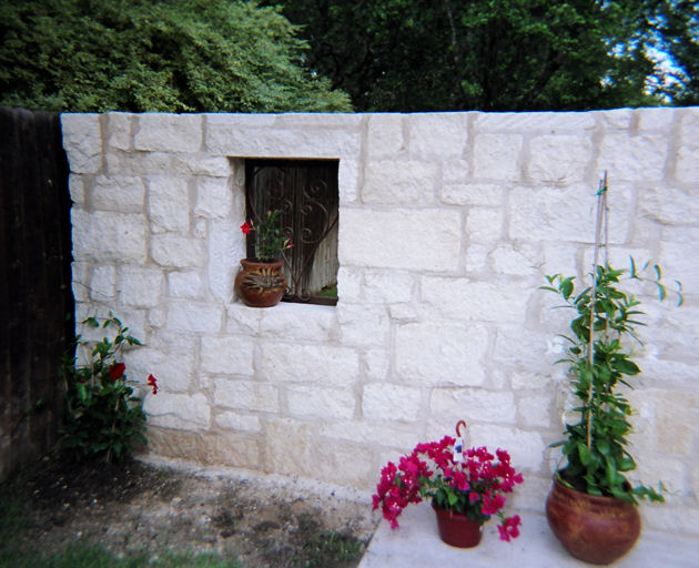 custom stone wall with archway - mediterrania iron